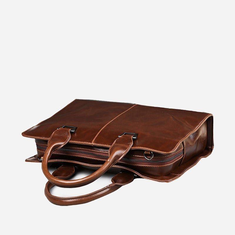 Sacoche bandoulière porte-documents et ordinateur pour homme en cuir marron.