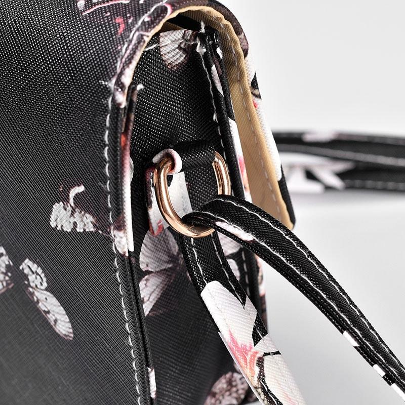details-sac-besace-bandouliere-femme-cuir-noir-fleurs