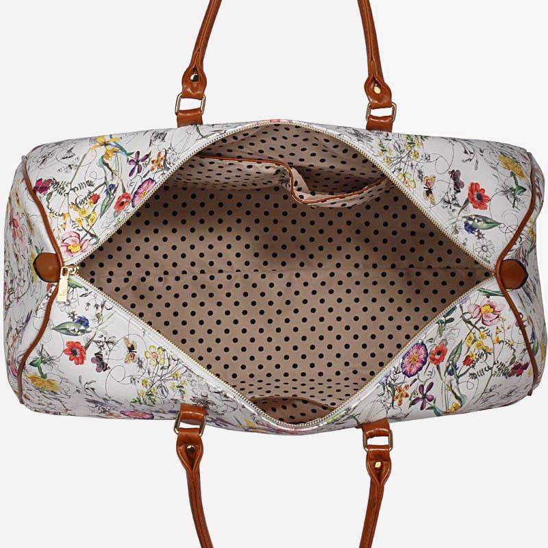 Intérieur du sac de voyage 48h blanc en toile pour femme avec ornement et anses en cuir.