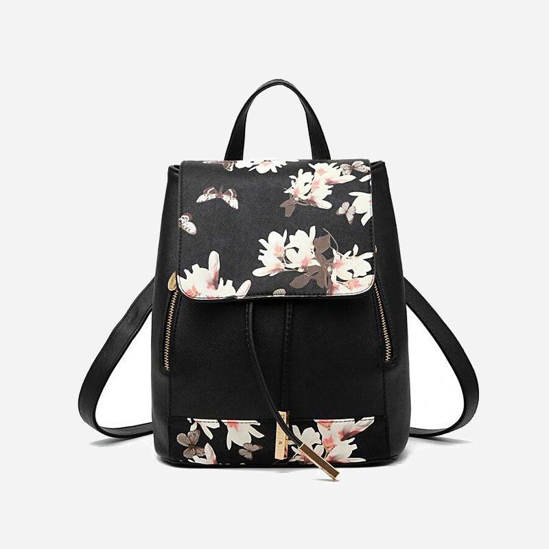 Sac à dos cuir texturé noir avec imprimé à fleurs.
