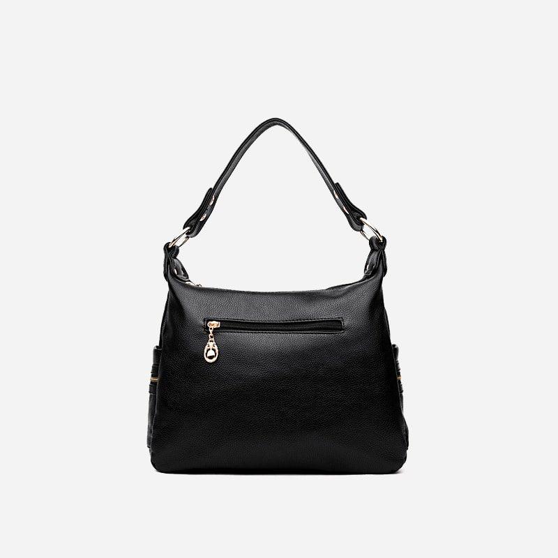 Sac bandoulière pour femme en cuir noir. Une poche à zip au verso.