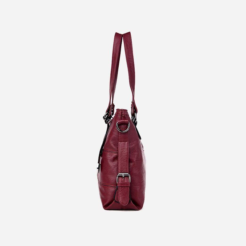 Sac bandoulière sac cabas pour femme en cuir rouge grenat. Côté.