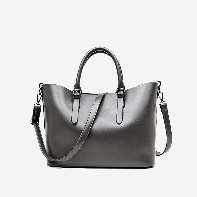Sac à main bandoulière pour femme et sac cabas en cuir gris.