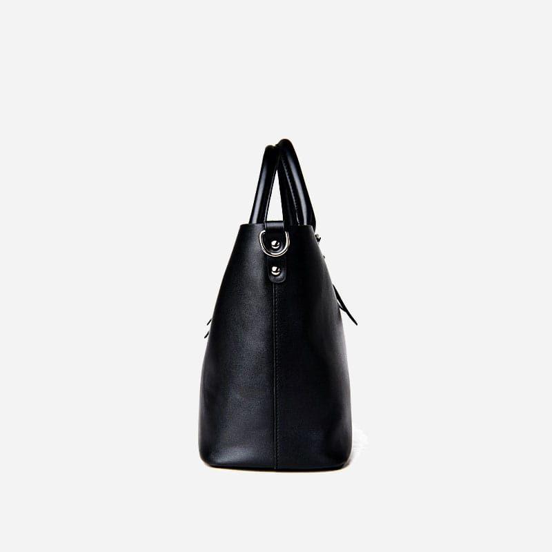 Sac à main bandoulière pour femme et sac cabas en cuir noir. Côté.