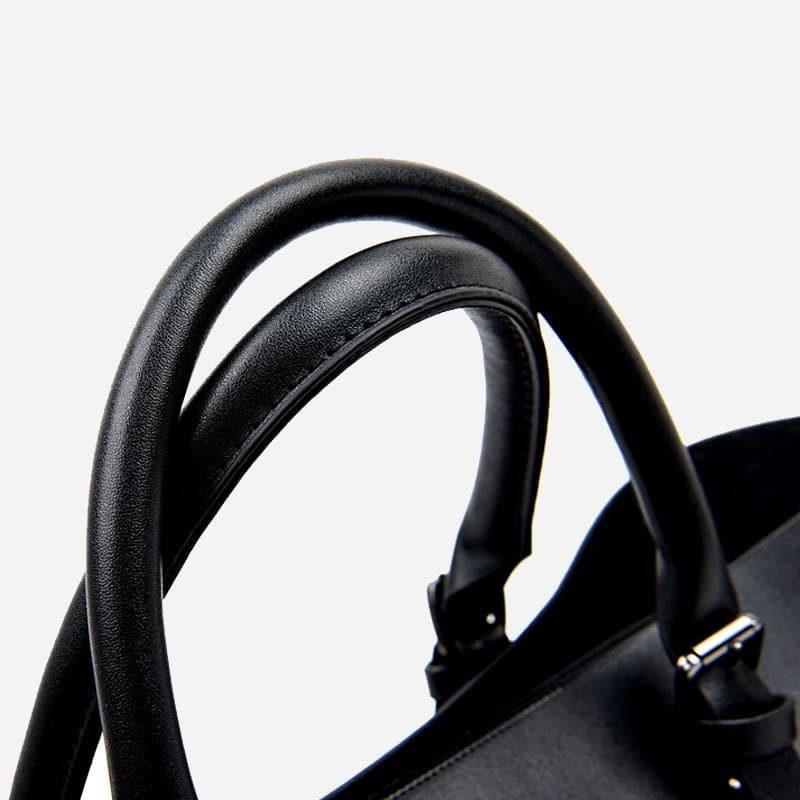 Sac à main bandoulière pour femme et sac cabas en cuir noir. Détails.