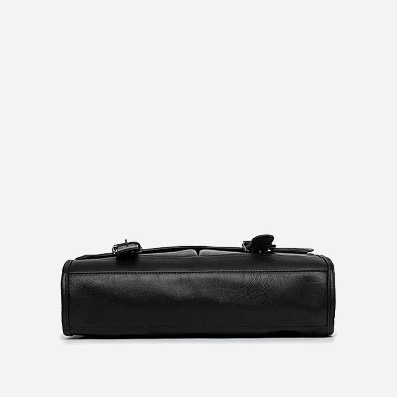 Dessous de la sacoche besace bandoulière pour homme façon cartable et cuir noir.
