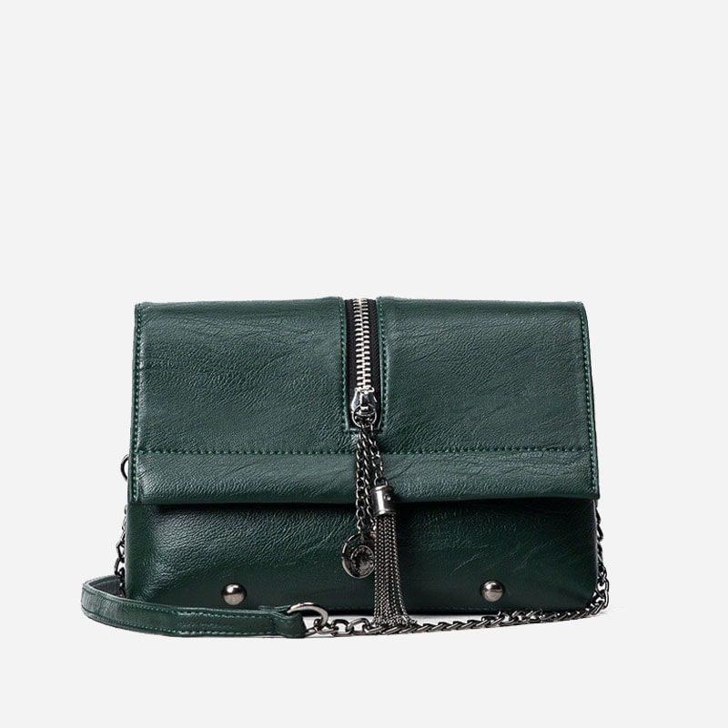 Sac besace vert pour femme avec bandoulière à chaîne et pompons.