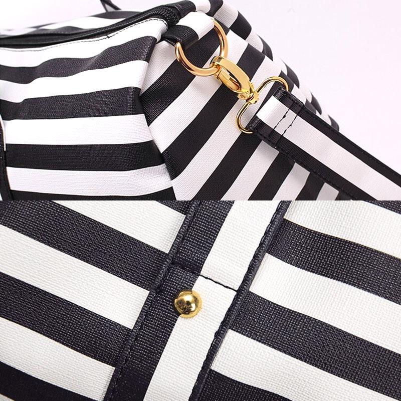Détails du sac de voyage marinière 48h pour femme en cuir noir.