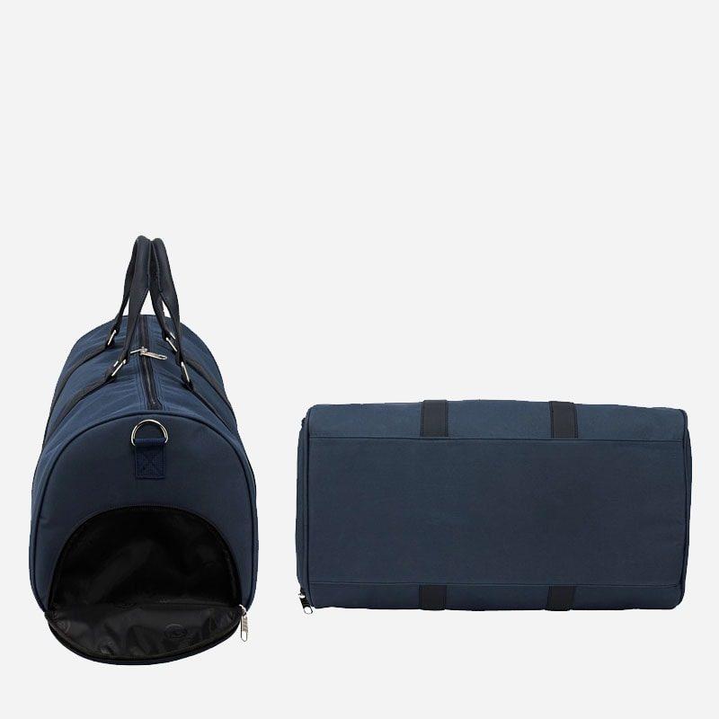 Côté et dessous du sac weekend 24h pour homme et femme en toile et en cuir de couleur bleu marine.