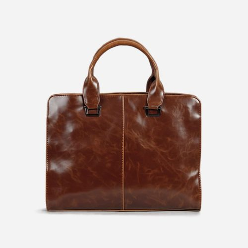 Sac porte-documents et ordinateur pour homme en cuir marron.