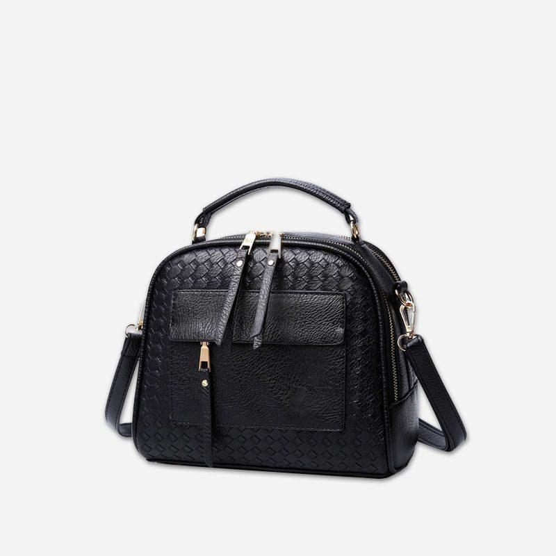 Sac à bandoulière et sac à main en cuir noir pour femme avec plusieurs poches zippées et poches intérieures. TKbag classic.