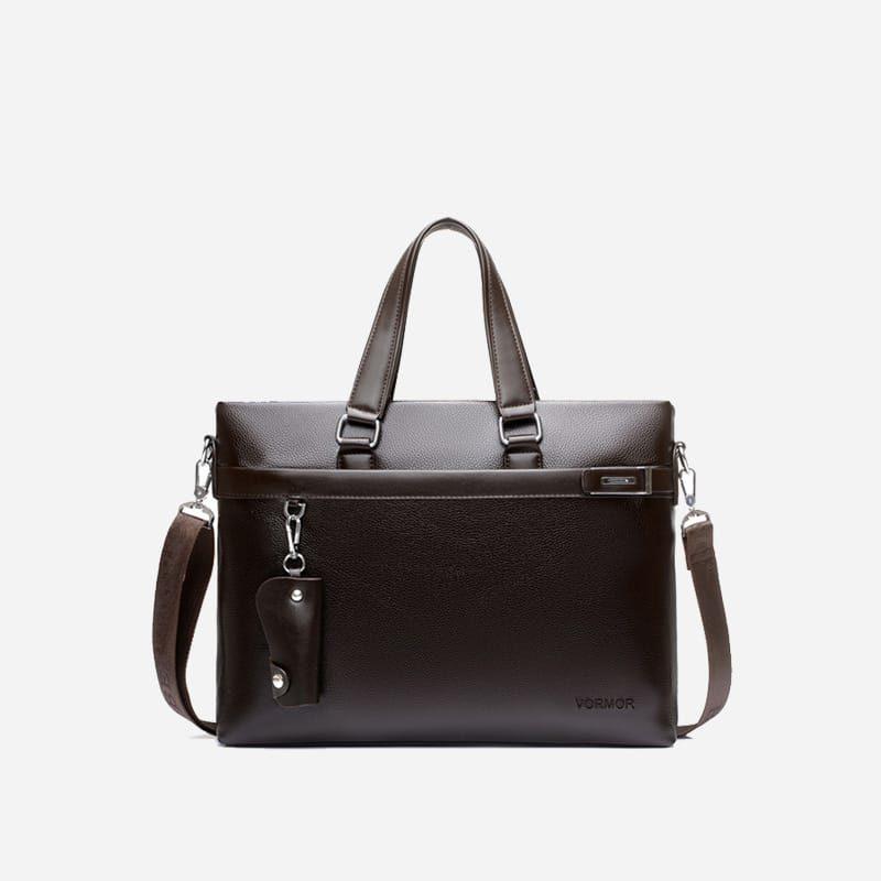 Sac à bandoulière et sac à main en cuir brun et marron pour homme avec plusieurs poches zippées et poches intérieures. Vormbag Design.