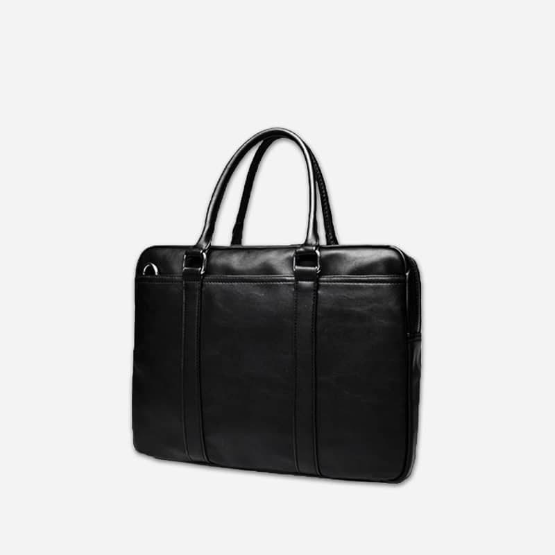 Sac à bandoulière et sac à main en cuir noir pour homme avec plusieurs poches zippées et poches intérieures. Vormbag Famous. Zoom1.