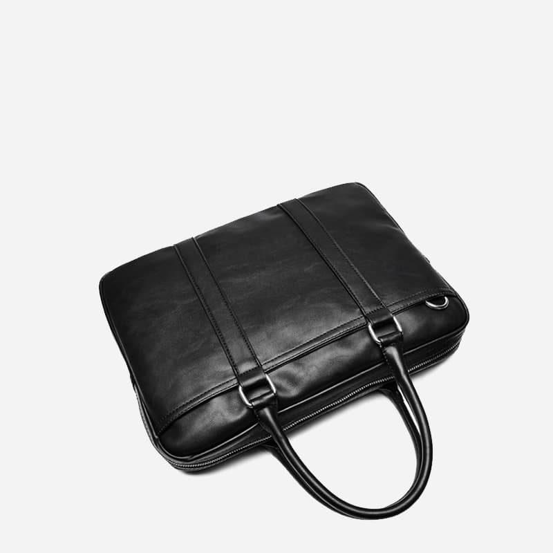 Sac à bandoulière et sac à main en cuir noir pour homme avec plusieurs poches zippées et poches intérieures. Vormbag Famous. Zoom2.