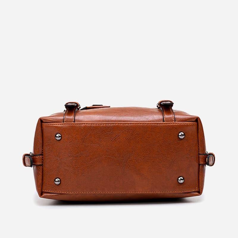 petit sac à main bandoulière pour femme en cuir marron et brun avec bandoulière épaule amovible. Dizbag Classic. Bottom.