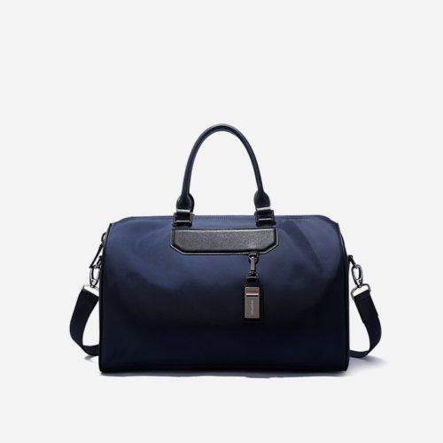 Sac à bandoulière et sacoche bleu pour homme avec plusieurs poches zippées et poches intérieures. Bopaibag Classic.