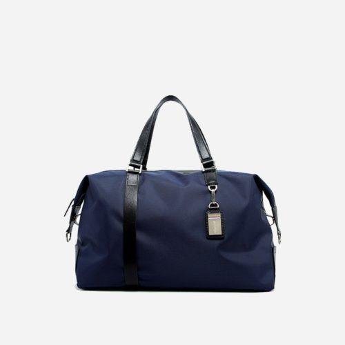 Sac à bandoulière et sacoche bleu pour homme avec plusieurs poches zippées et poches intérieures. Bopaibag Design.