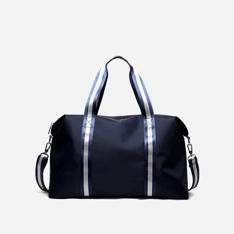 Sac à bandoulière et sacoche bleu pour homme avec plusieurs poches zippées et poches intérieures. Bopaibag Traveler.