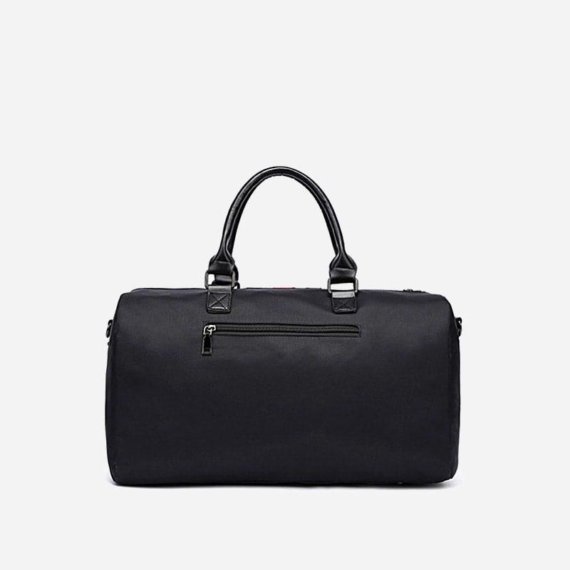 Sac de voyage noir pour homme avec bandoulière faisant également office de sac weekend en fonction de la taille. Verso.