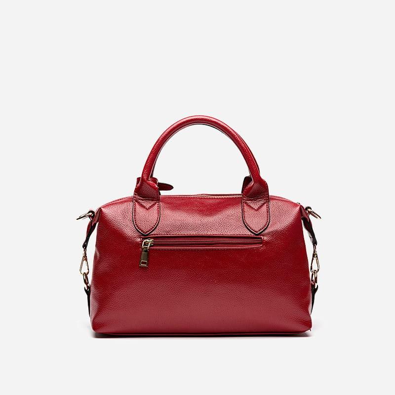 Verso du sac à main bandoulière fourre tout pour femme en cuir rouge.