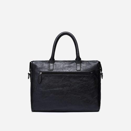Sacoche pour homme en cuir noir avec bandoulière, rabat et poignée pour être portée comme sac à main. Verso.