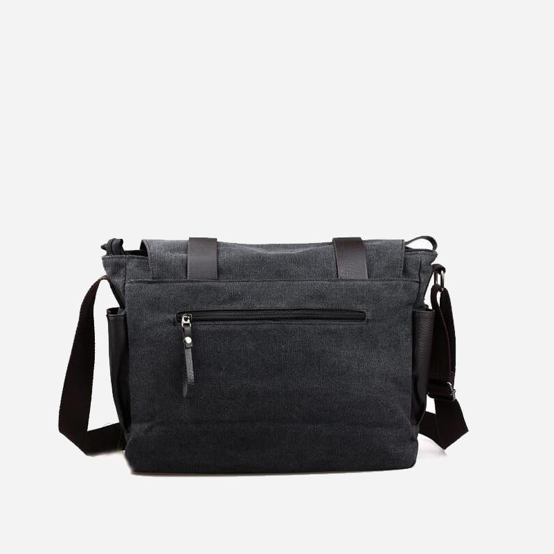 Verso du sac besace pour homme noir en toile et en cuir.