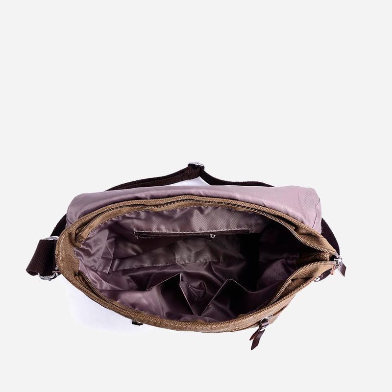 Intérieur du sac besace bandoulière en toile brun pour homme.