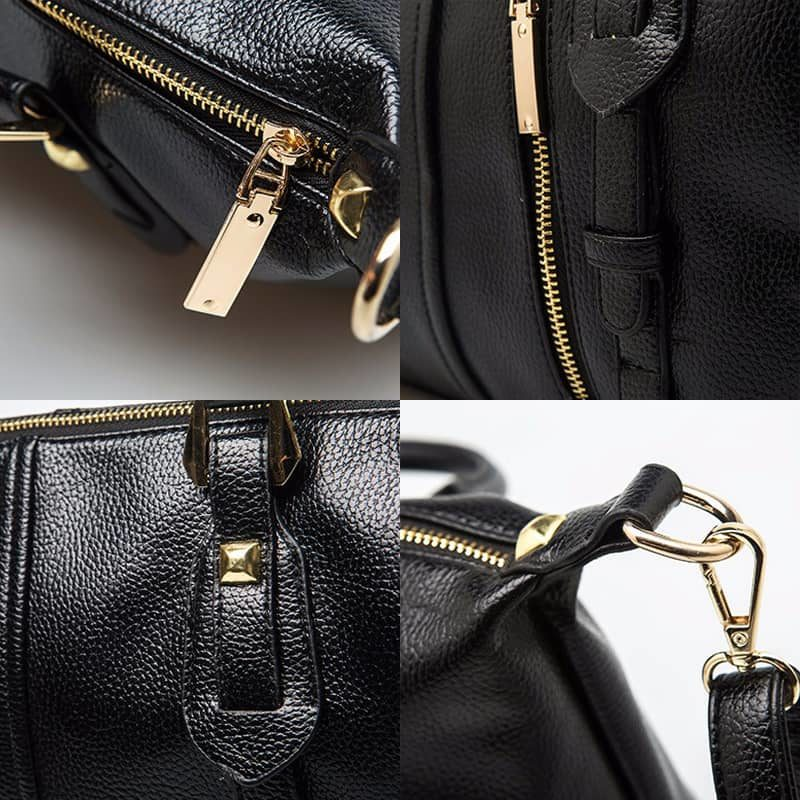 Détails du sac cabas en cuir noir pour femme avec bandoulière, languettes et fermeture décorative.