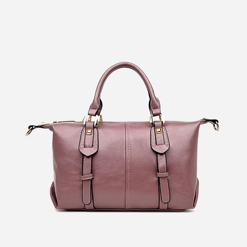 Verso du sac cabas en cuir rose pour femme avec bandoulière, languettes et fermeture décorative.