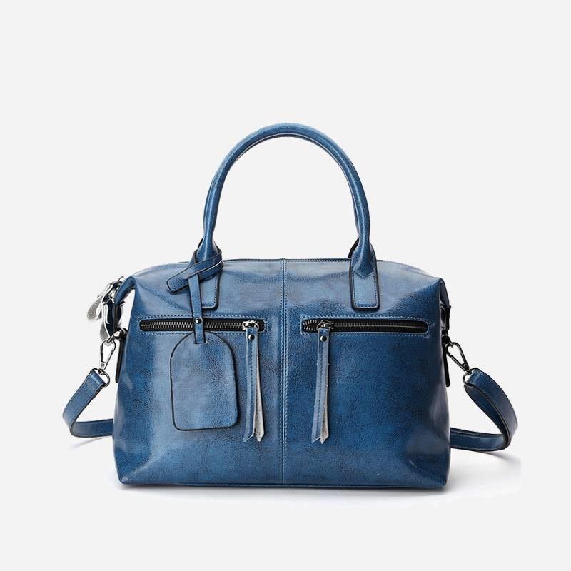 Sac à main bandoulière pour femme en cuir véritable de couleur bleu.
