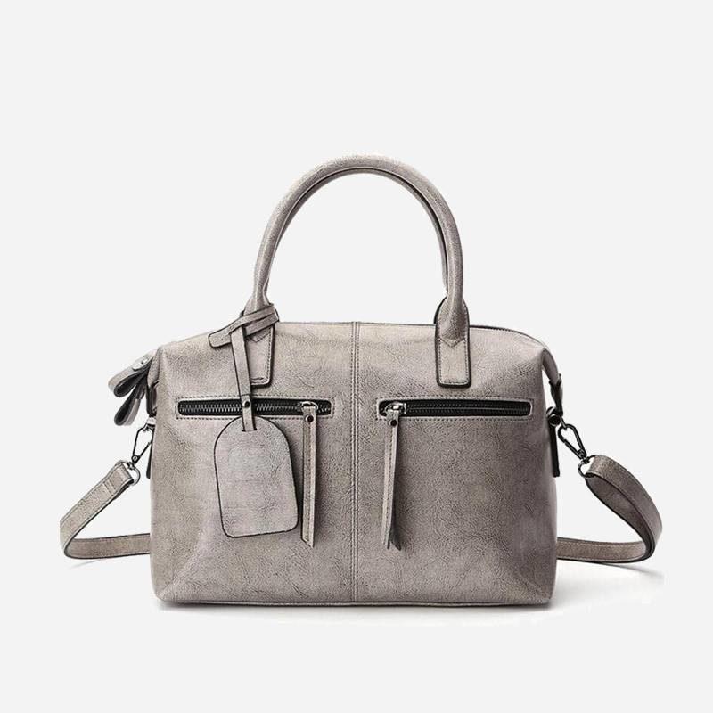 Sac à main bandoulière pour femme en cuir véritable de couleur gris.
