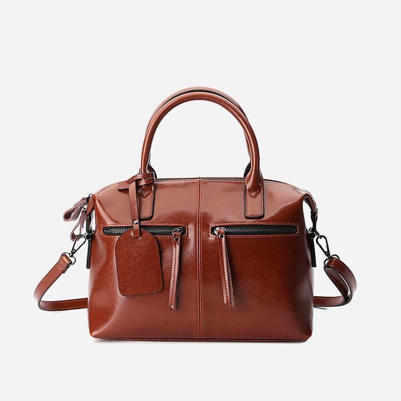 Sac à main bandoulière pour femme en cuir véritable de couleur marron.