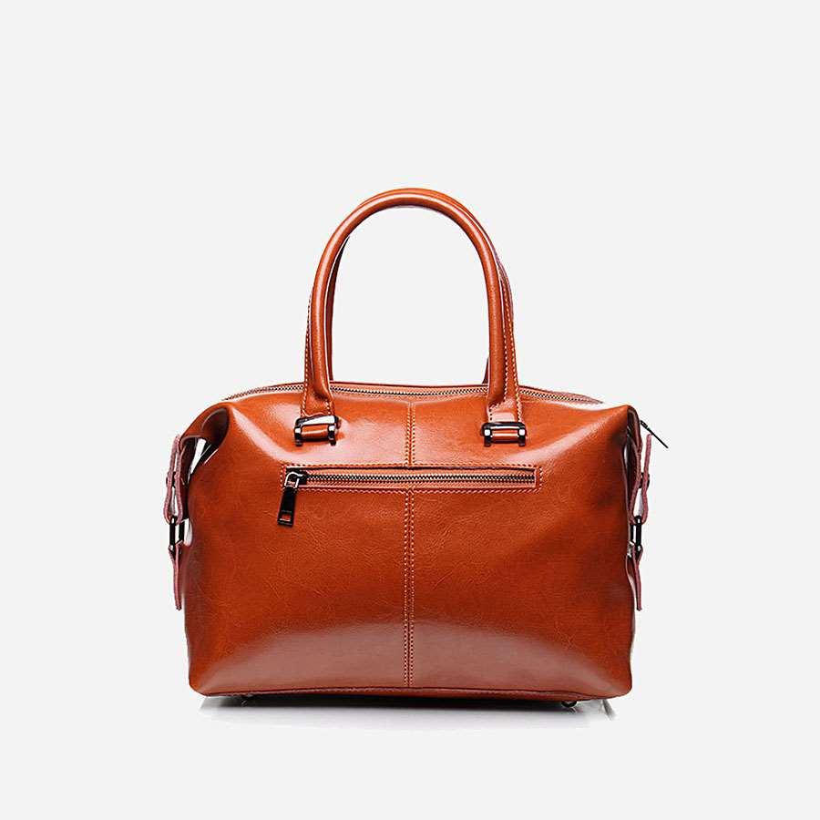 Verso du sac à main pour femme marron en cuir véritable avec bandoulière amovible.