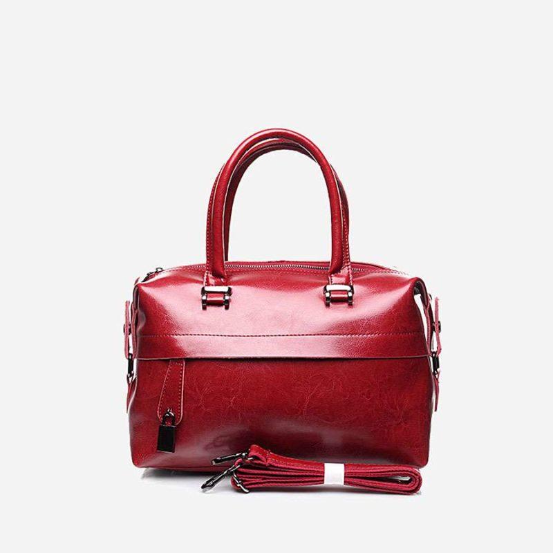 Sac à main pour femme rouge en cuir véritable avec bandoulière amovible.
