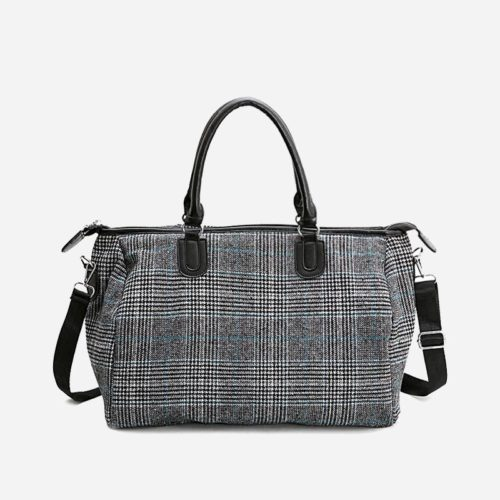 Sac week-end et sac de voyage gris en toile avec motifs pour femme.