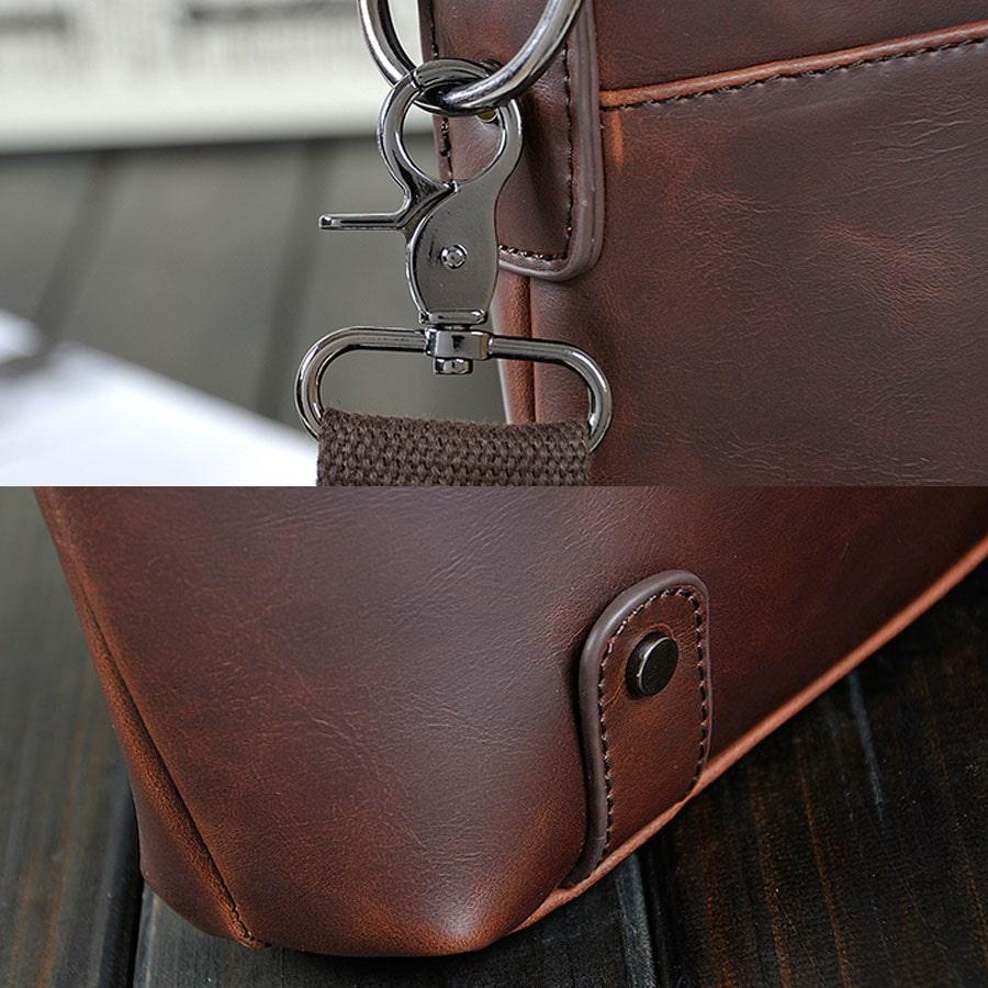 Détails bandoulière, mousqueton, boucle de ceinture et divers parties de la sacoche pour homme en cuir.