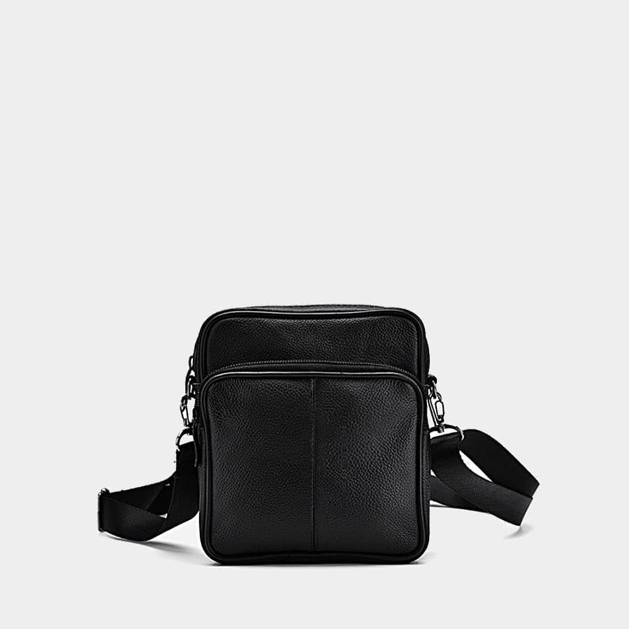 Petite sacoche trotteur homme en cuir noir véritable avec poche à zip.