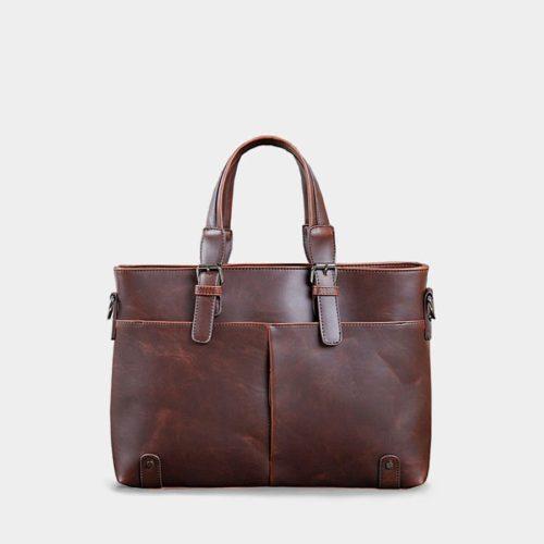 Sacoche porte-document à main et à bandoulière en cuir brun.