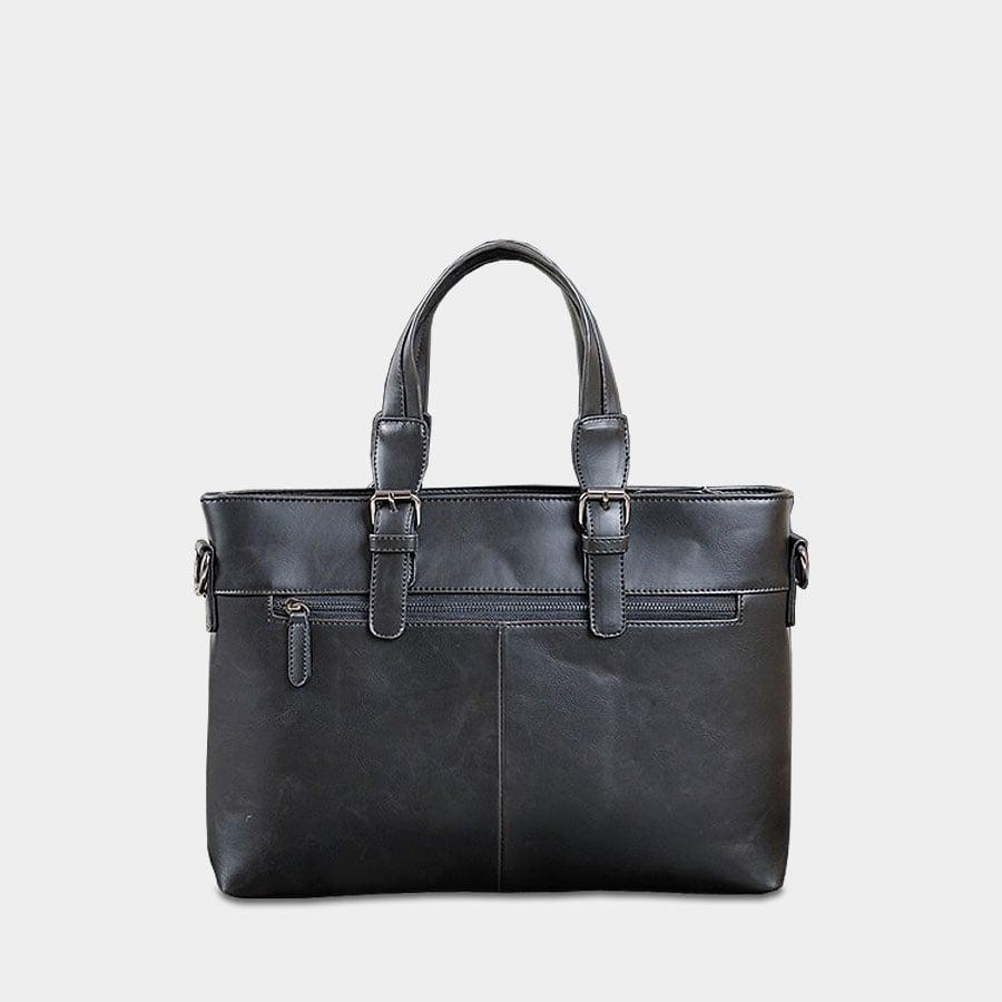 Verso du sac porte-document à main et à bandoulière en cuir noir.