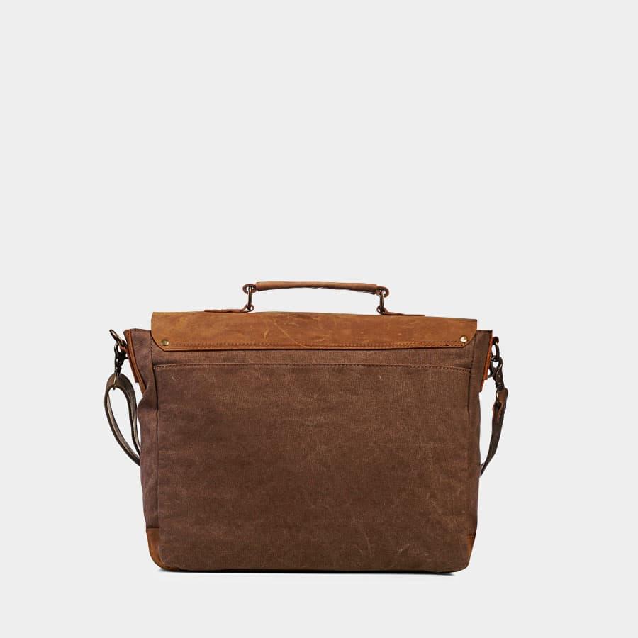 Verso de la sacoche façon besace en toile couleur brun et cuir véritable marron.