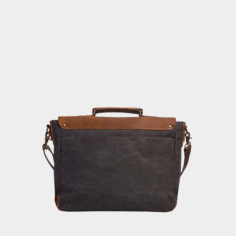 Verso de la sacoche façon besace en toile bleu et cuir véritable marron.