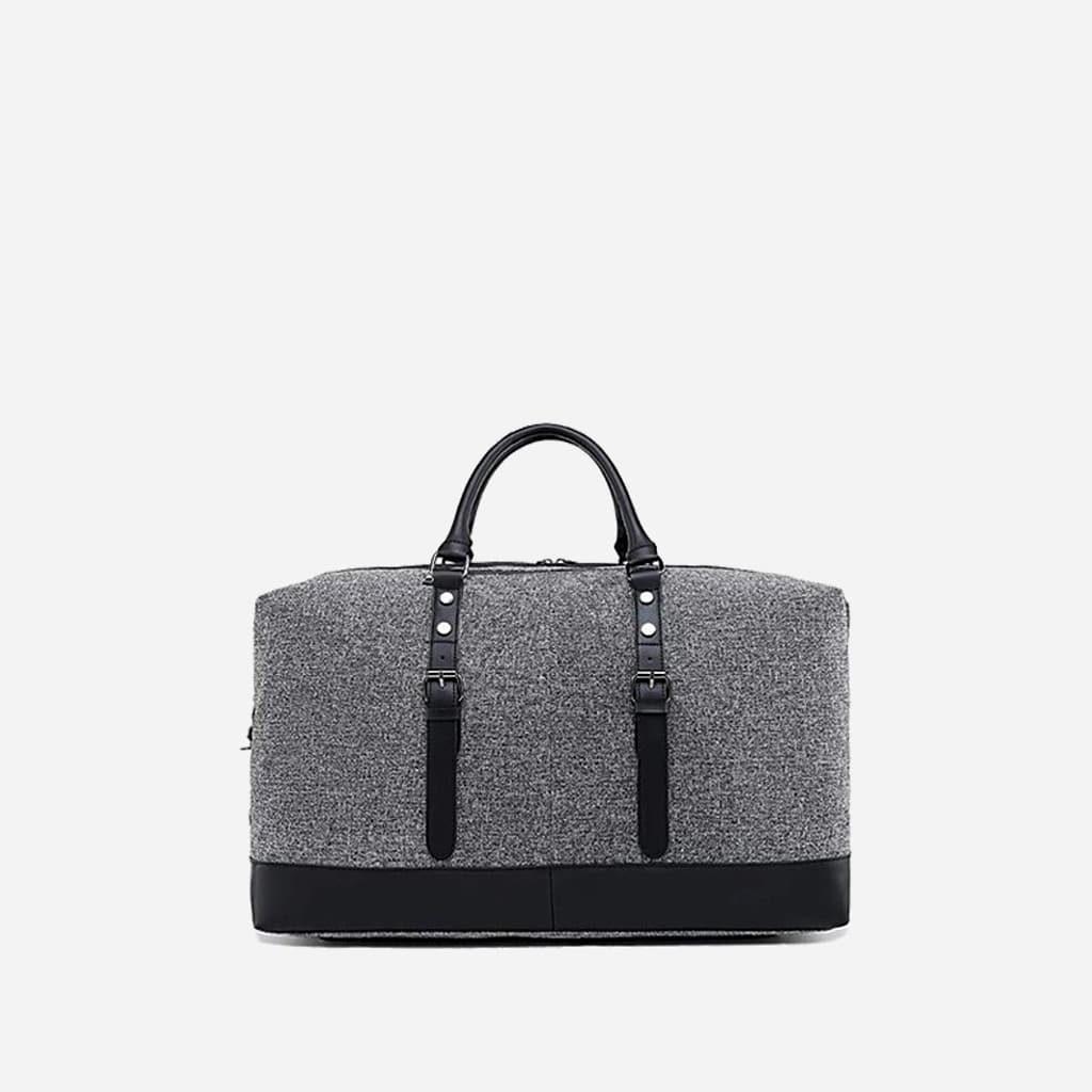 Arrière du grand sac de voyage 48h en toile de tissus et en cuir gris et noir.