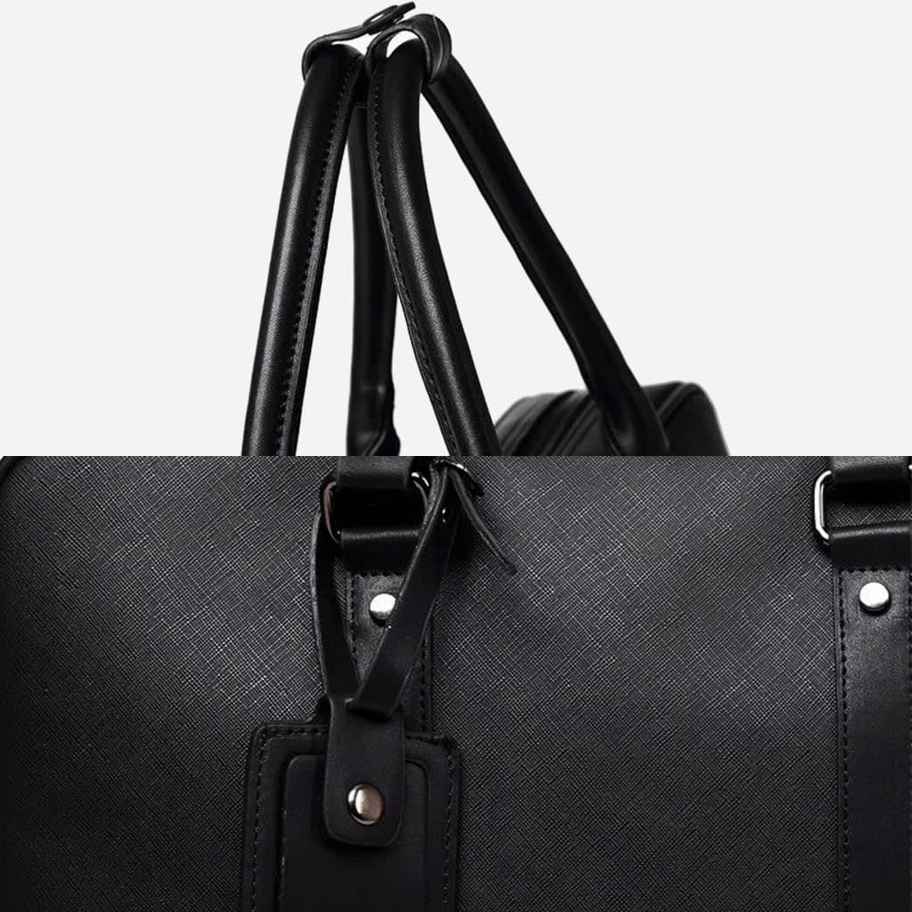 Zomm anses rondes (poignées) et détail du cuir noir saffiano.