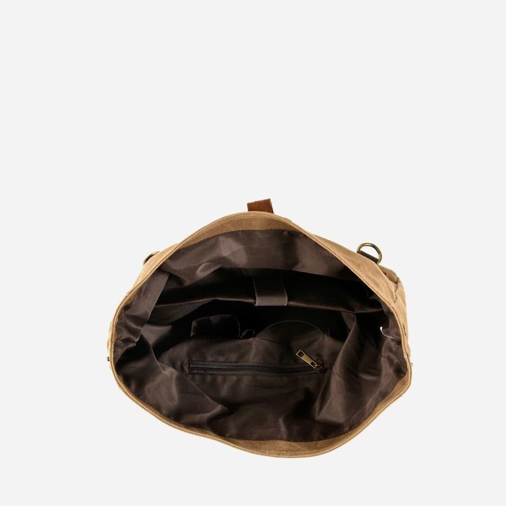Intérieur de grande sacoche besace en toile enduite et cuir véritable marron et brun pour homme