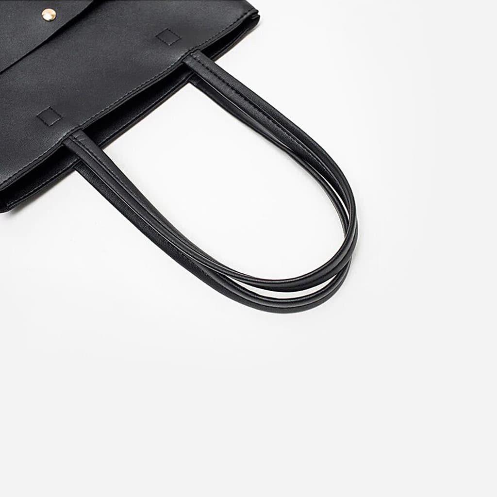 Détails anses grand sac cabas cuir noir pour femme format vertical