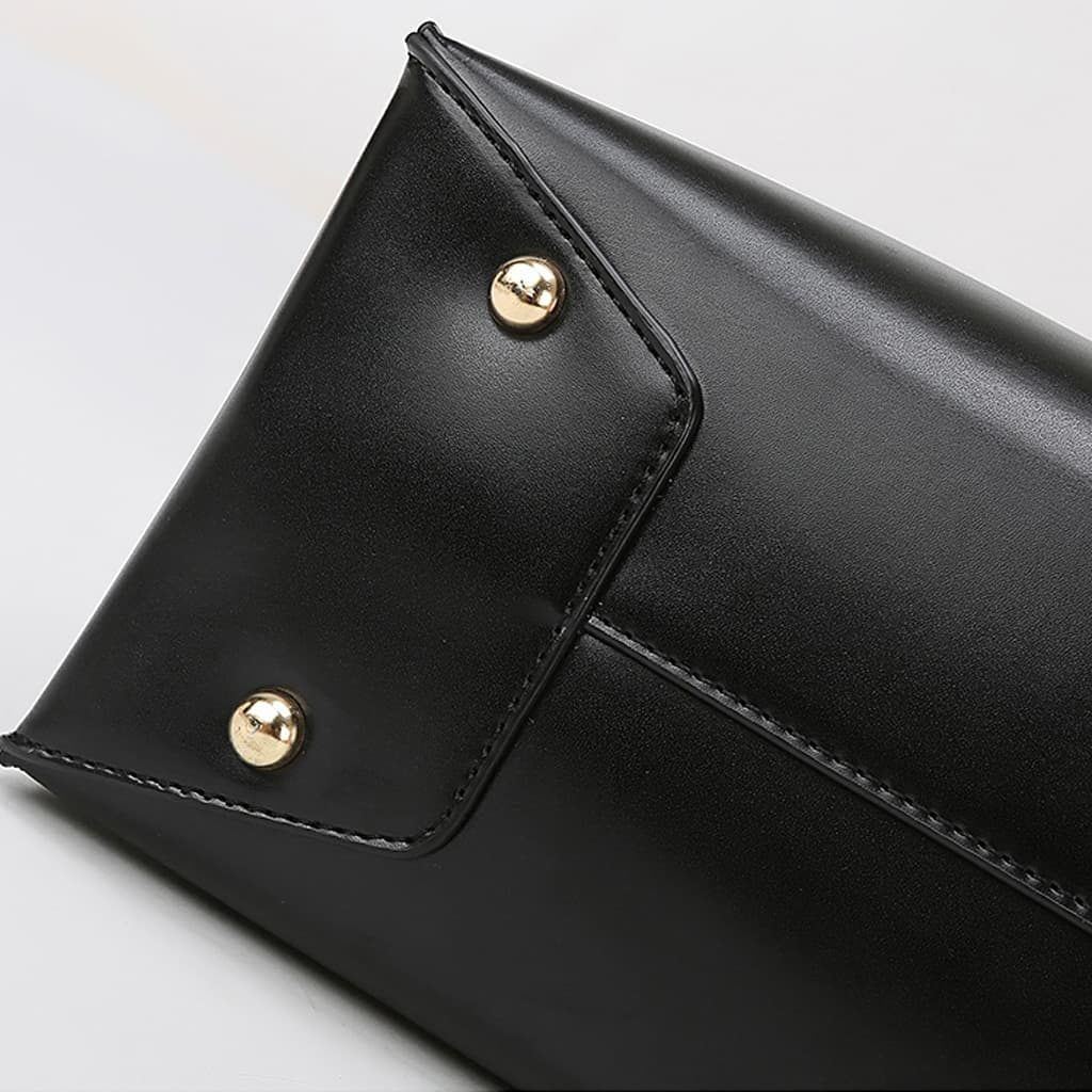 Dessous du sac cabas pour femme en cuir noir avec anse asymétrique et œillets