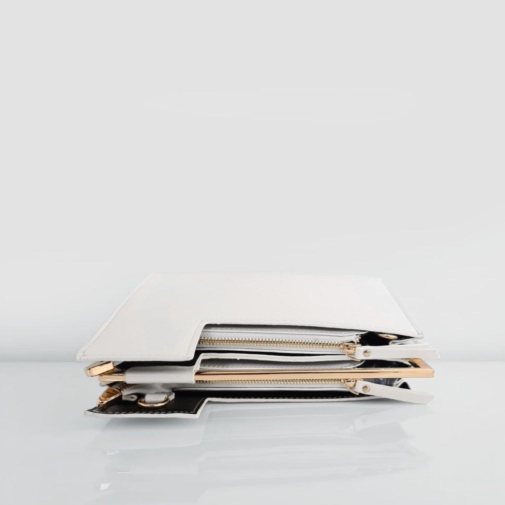 dessus du sac à main cuir blanc femme asymétrique avec anse métallique dorée