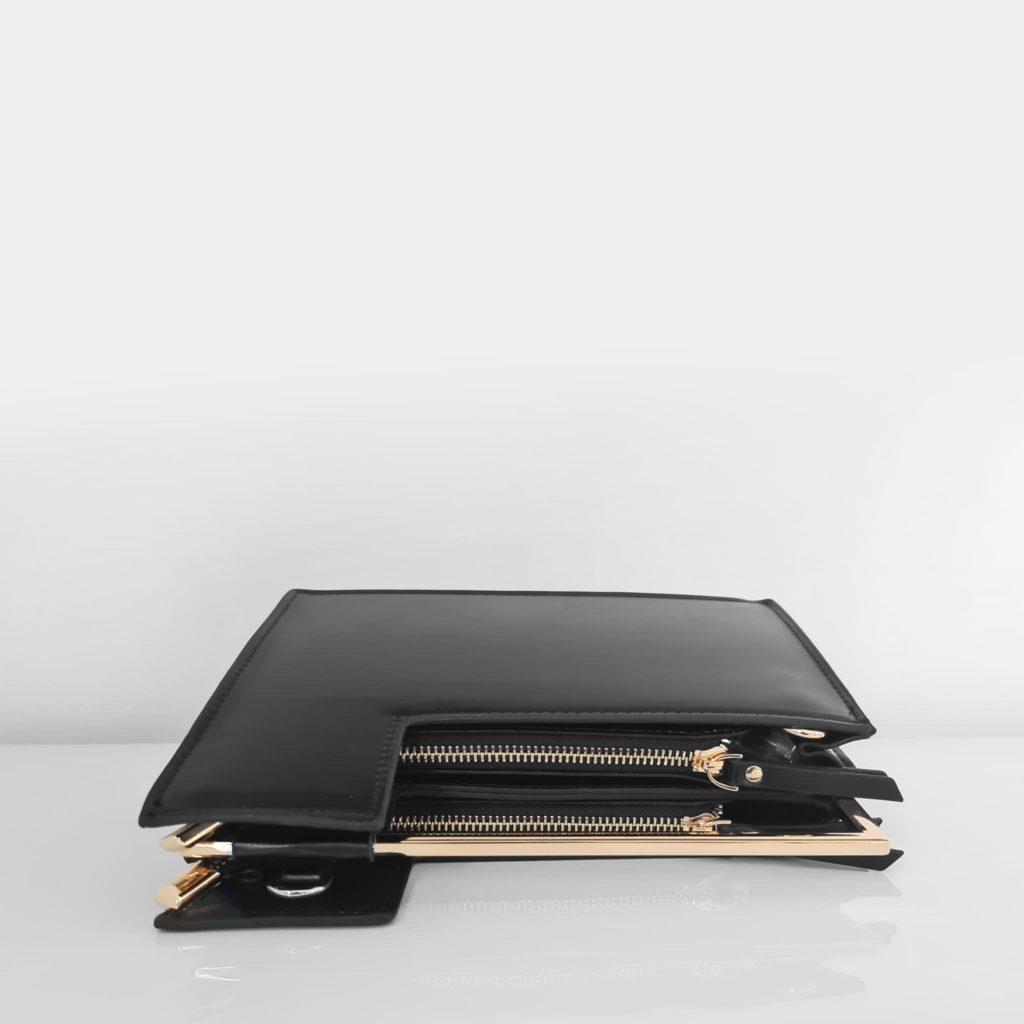 Dessus du sac à main cuir noir femme asymétrique avec anse métallique dorée