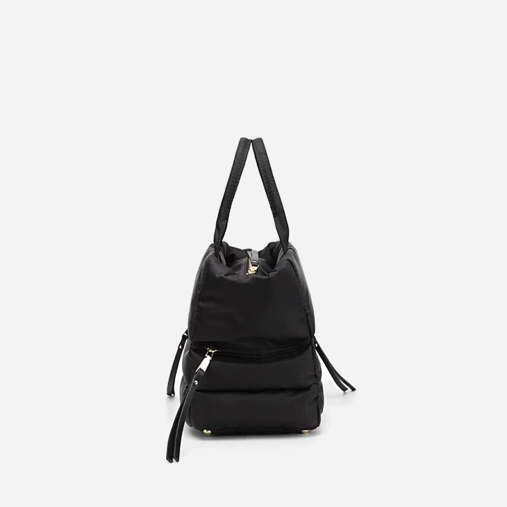 Côté du sac à main cabas rembourré coton noir